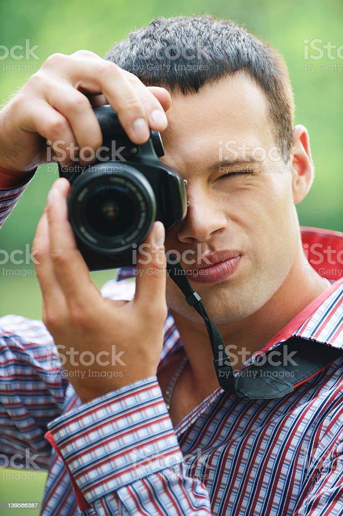 young man taking photos royalty-free stock photo