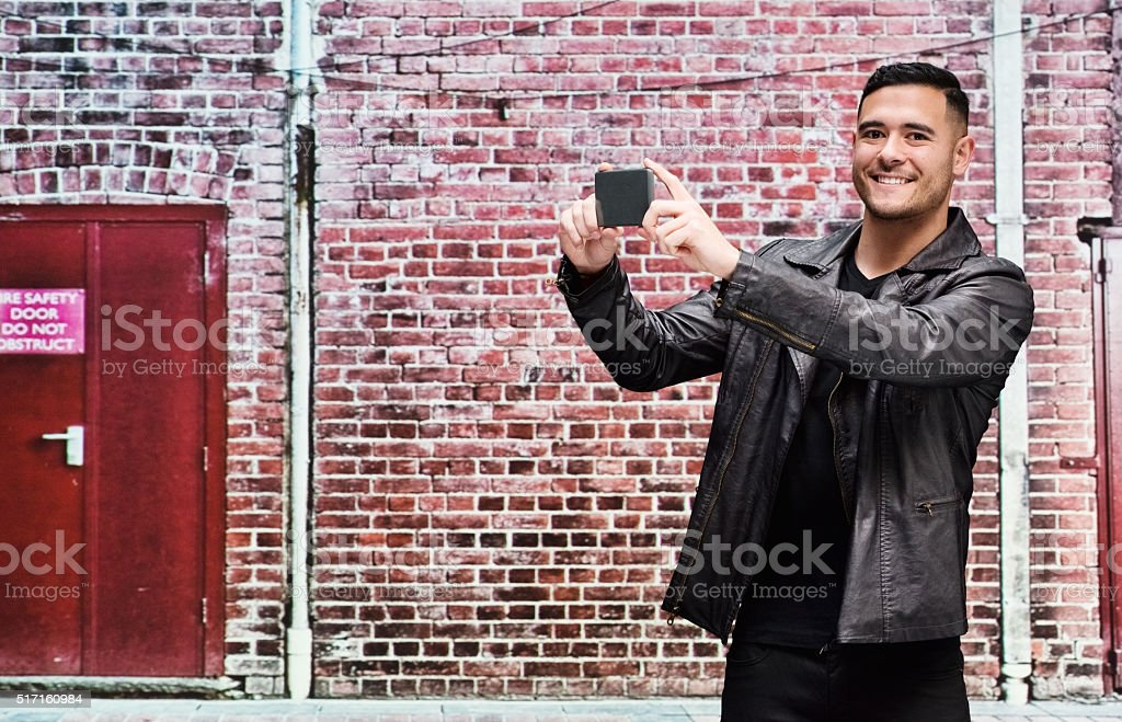 Young man taking picture stock photo