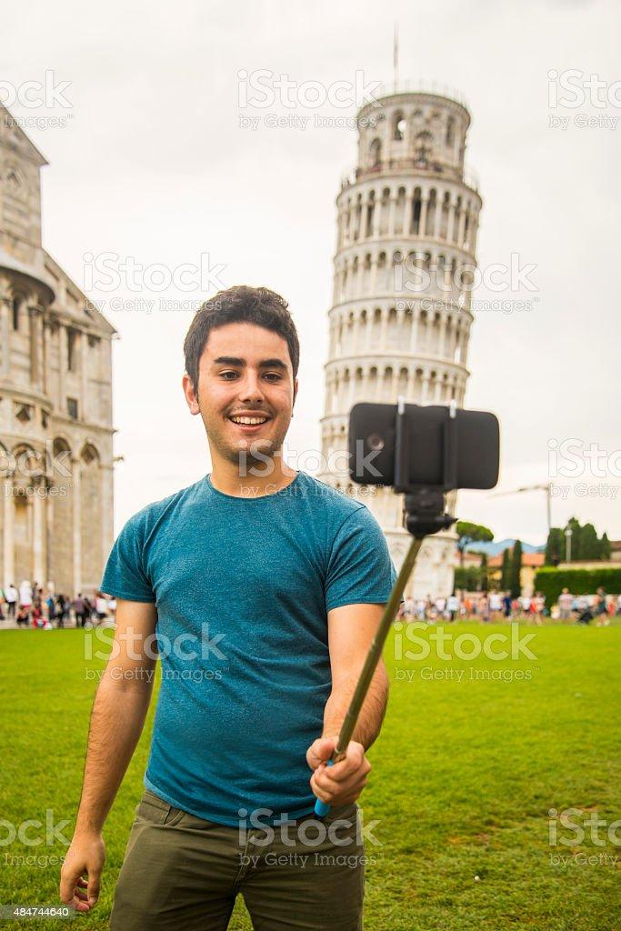 Young man taking selfie in Pisa stock photo