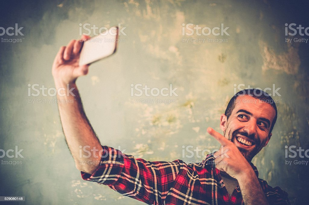 Young man taking selfie stock photo