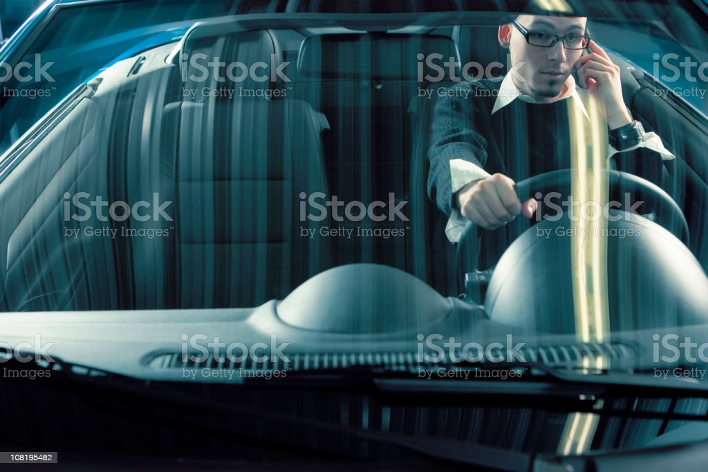 Young Man Talking on Cell Phone and Driving Sports Car royalty-free stock photo