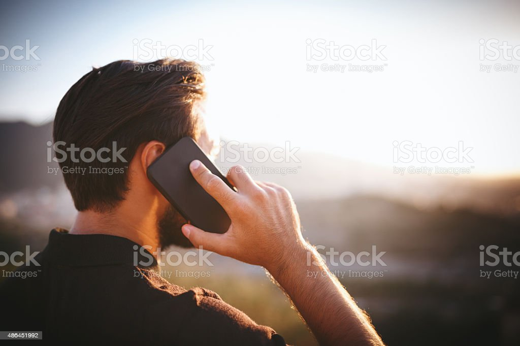 Young man talking on phone stock photo