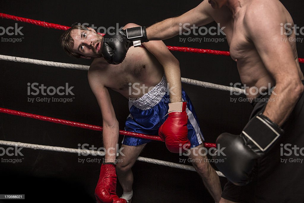Young Man Tangled Up In Boxing Ring Ropes stock photo