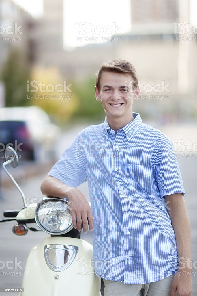 Young Man Teenager with Moped Scooter in Urban City royalty-free stock photo