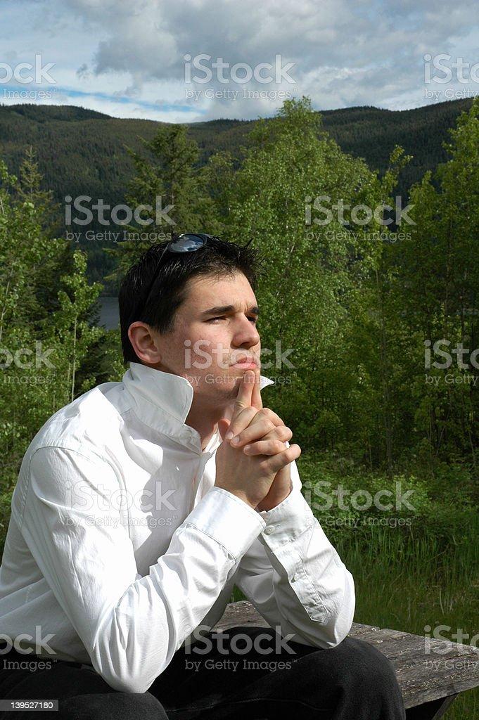 Young man thinking 2 royalty-free stock photo