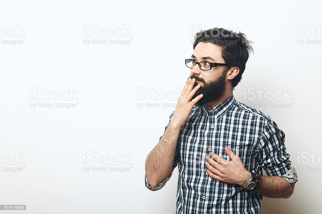 young man thinking and being surprised stock photo
