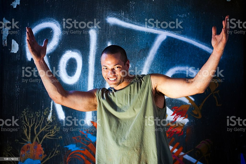 Young Man Throwing Arms Up royalty-free stock photo