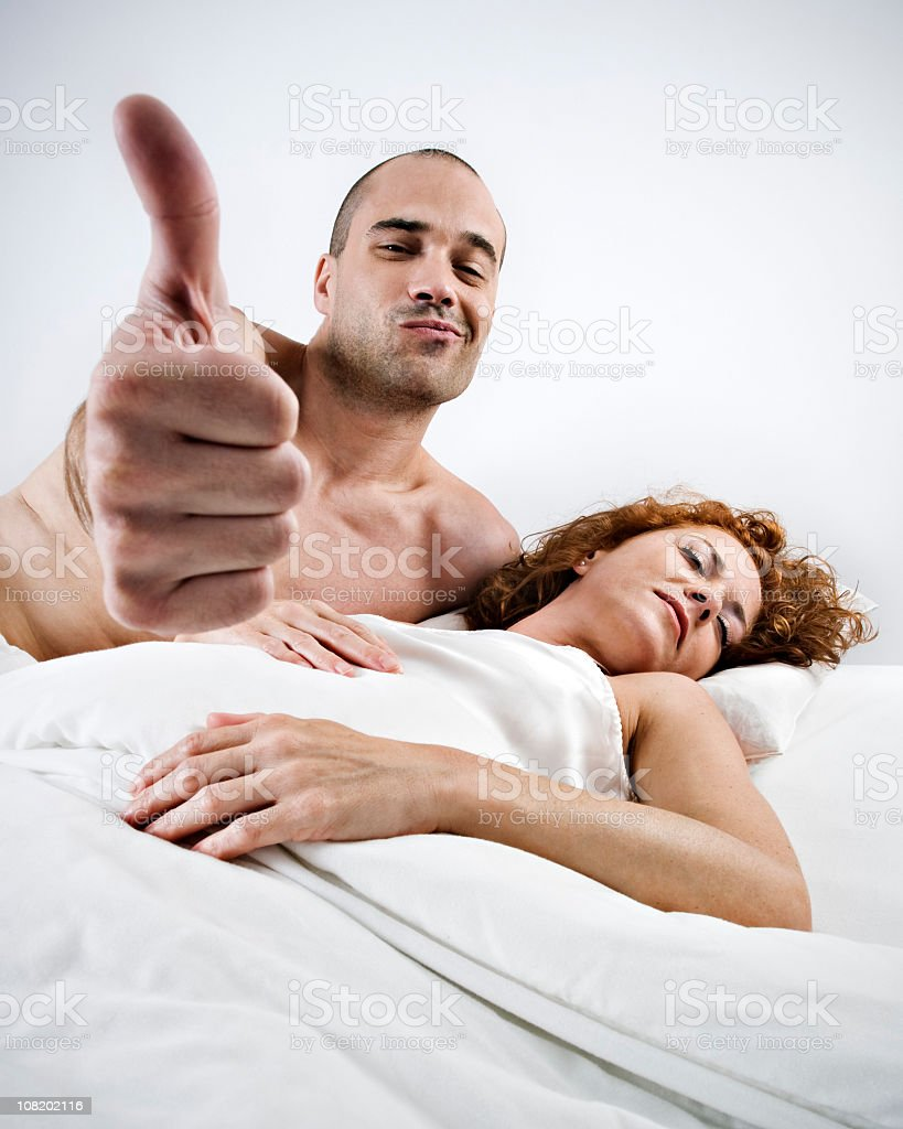 Young Man Thumbs Up while Woman Sleeps royalty-free stock photo