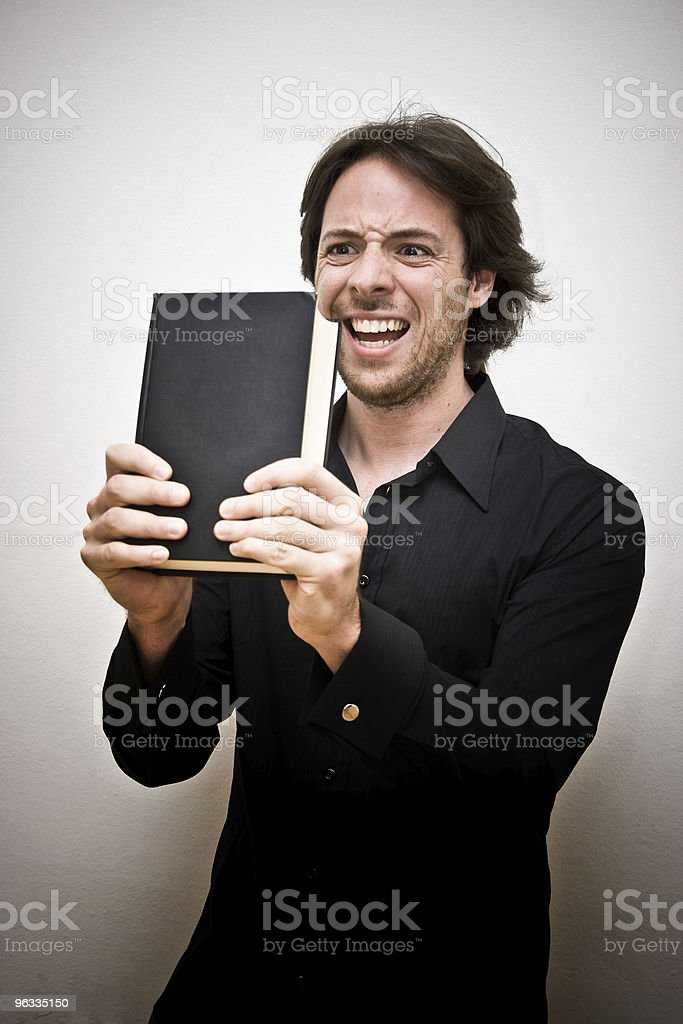 Young man tired of books royalty-free stock photo