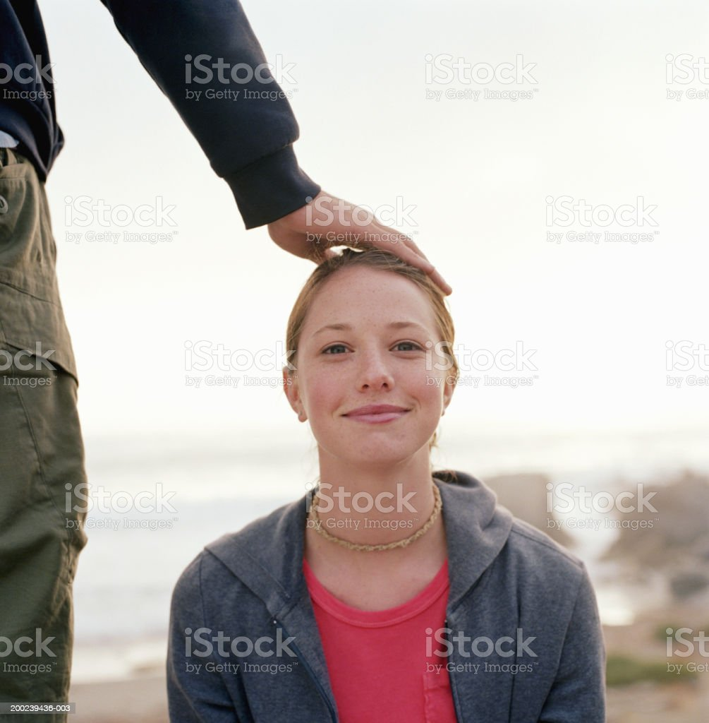 Young man touching woman's head royalty-free stock photo