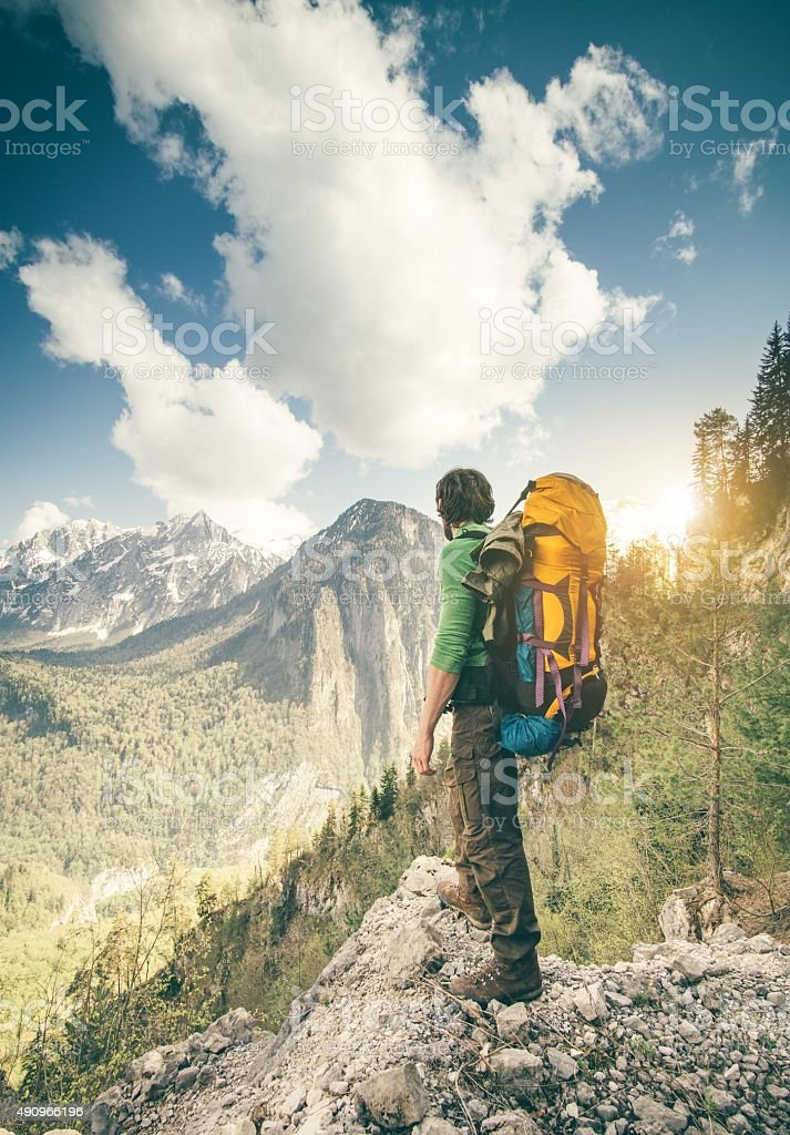 Young Man Traveler with backpack relaxing outdoor stock photo