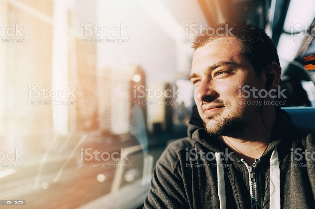 Young man  traveling in the train stock photo