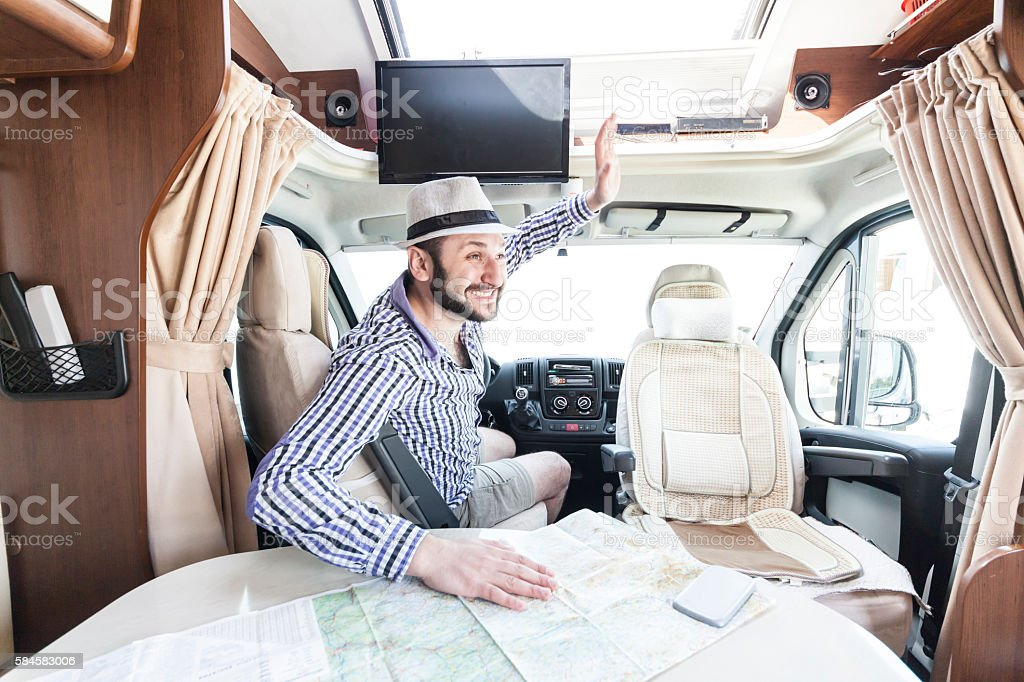 Young man traveling with a caravan stock photo