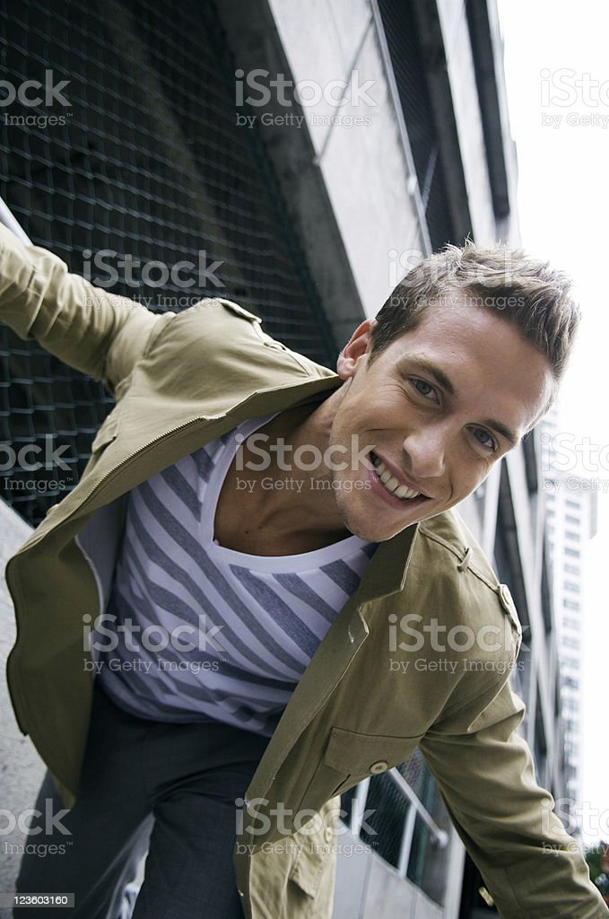 Young man tripping and goofing in the city royalty-free stock photo
