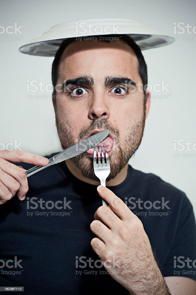 young man trying to eat his own tongue stock photo