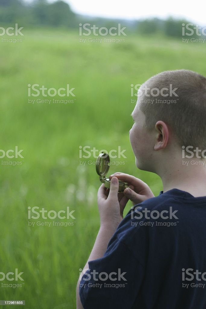 Young Man Using a Field Compass royalty-free stock photo