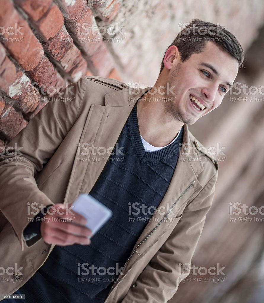 Young man using a smart phone stock photo