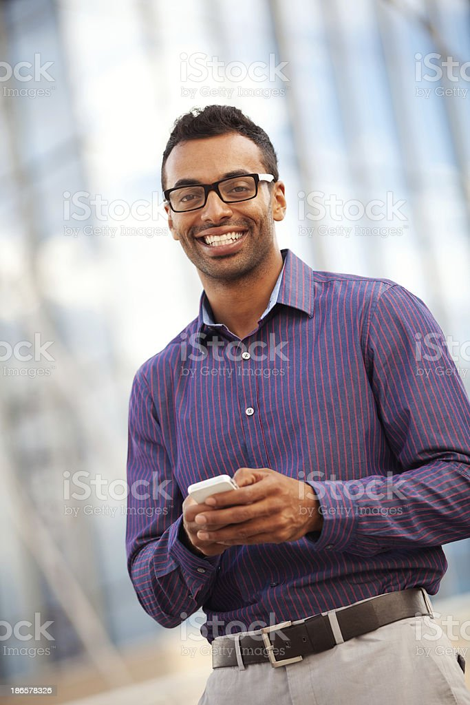 Young Man Using A Smartphone royalty-free stock photo