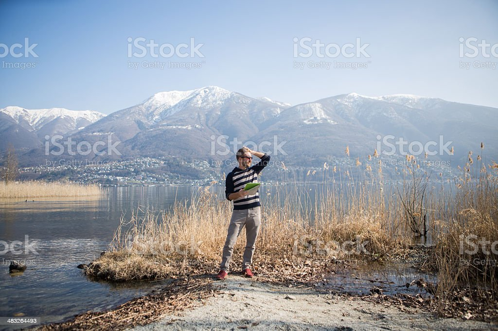 Young man using digital tablet royalty-free stock photo