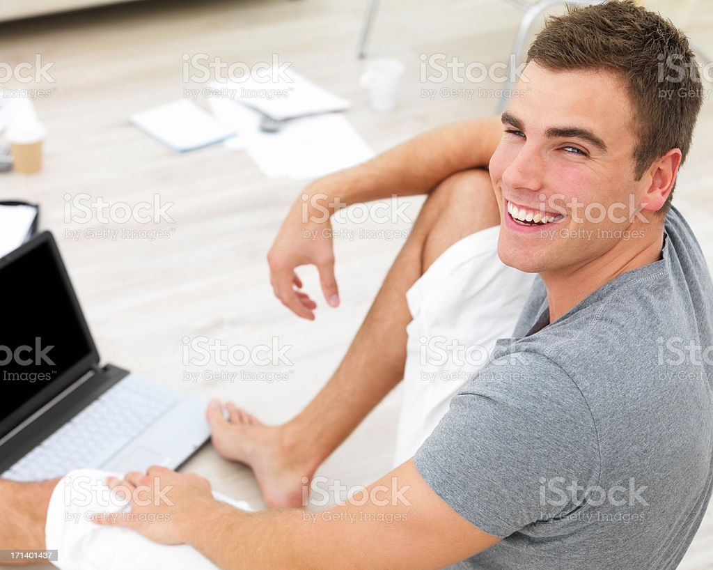 Young man using laptop or working from home royalty-free stock photo
