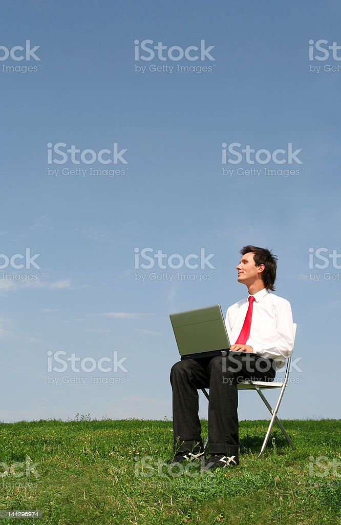 Young man using laptop outdoors royalty-free stock photo