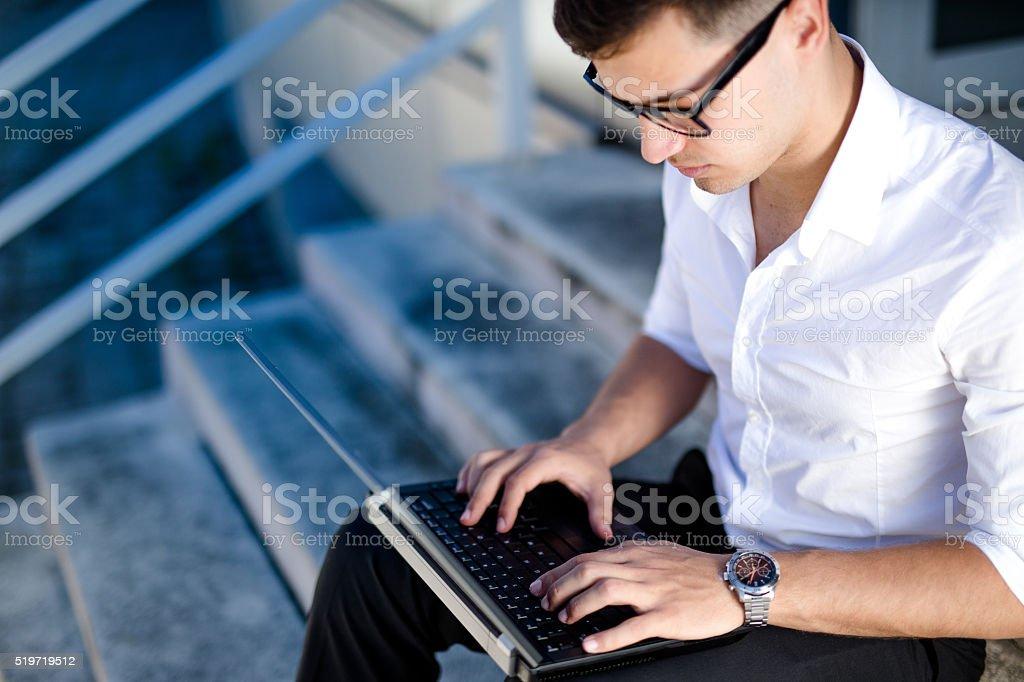 Young Man Using Laptop stock photo