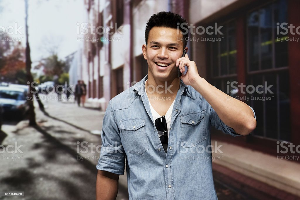 Young man using mobile phone in outdoors royalty-free stock photo