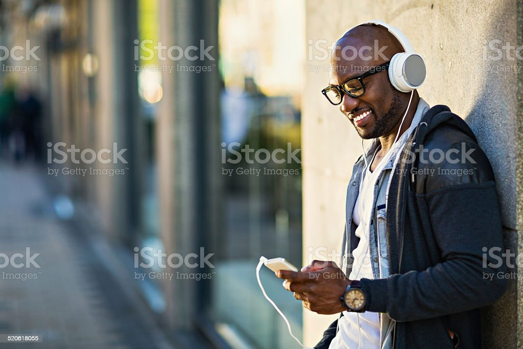 Young man using smart phone stock photo