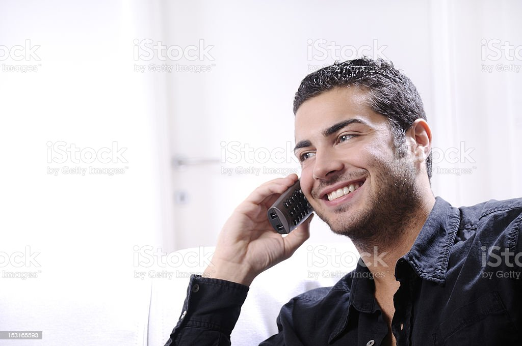 young man using telephone stock photo