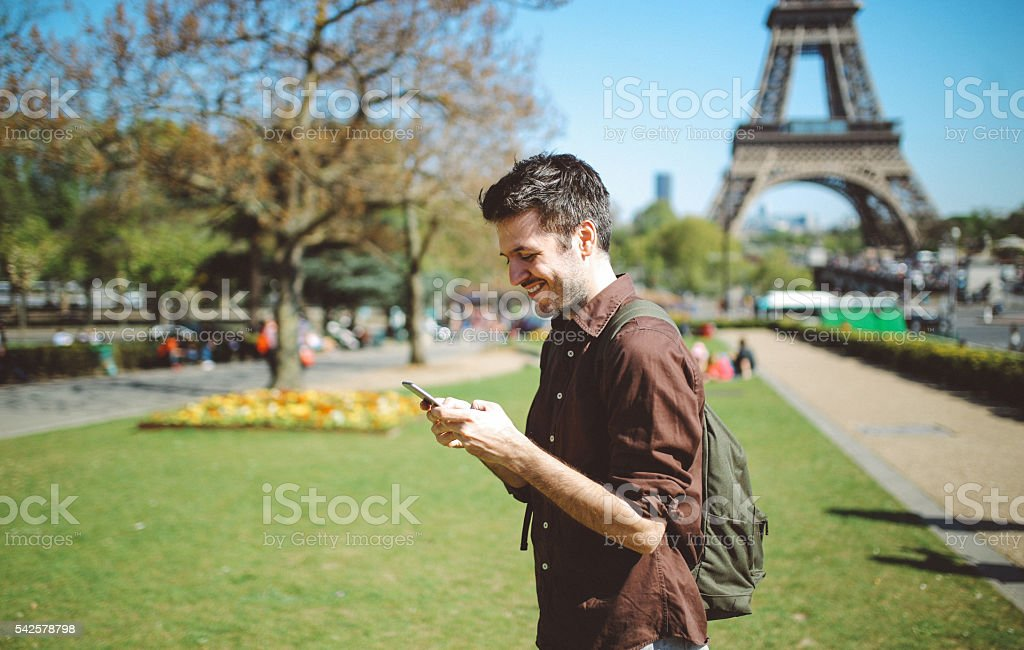 Young man using the smartphone stock photo