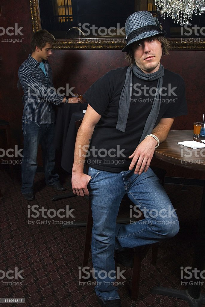 Young man waiting for his date at the nightclub stock photo