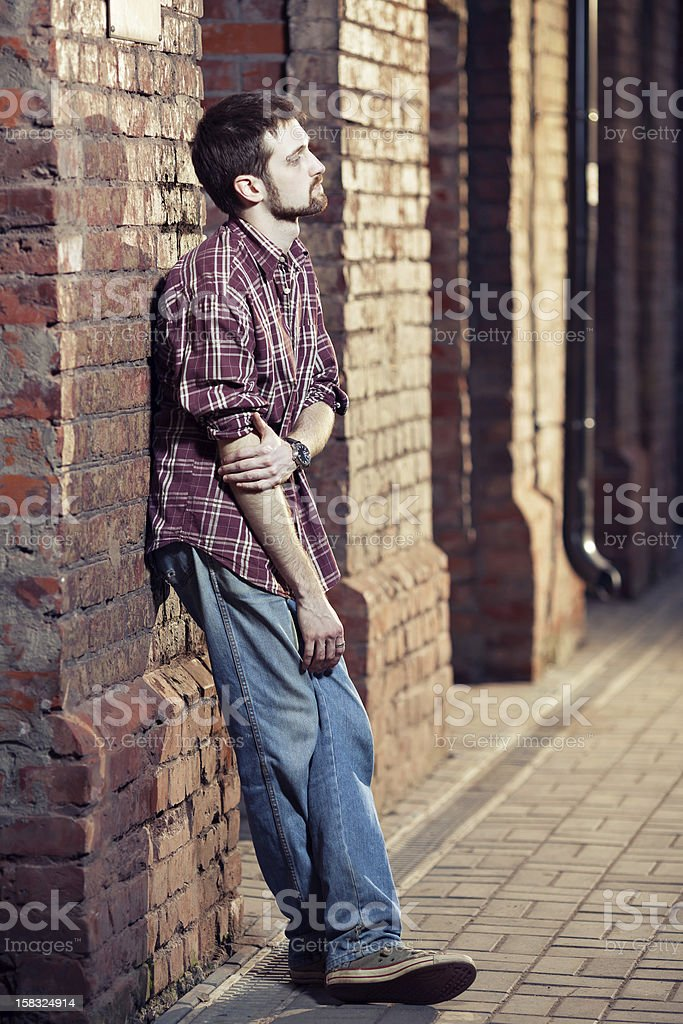 Young man waiting for someone royalty-free stock photo