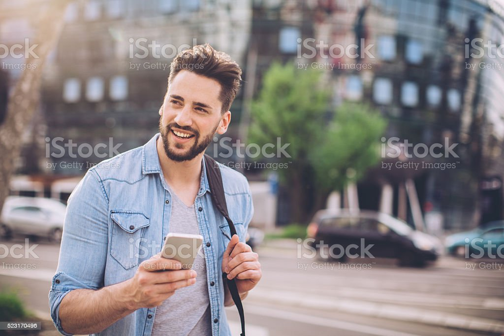 Young man waiting for taxi stock photo