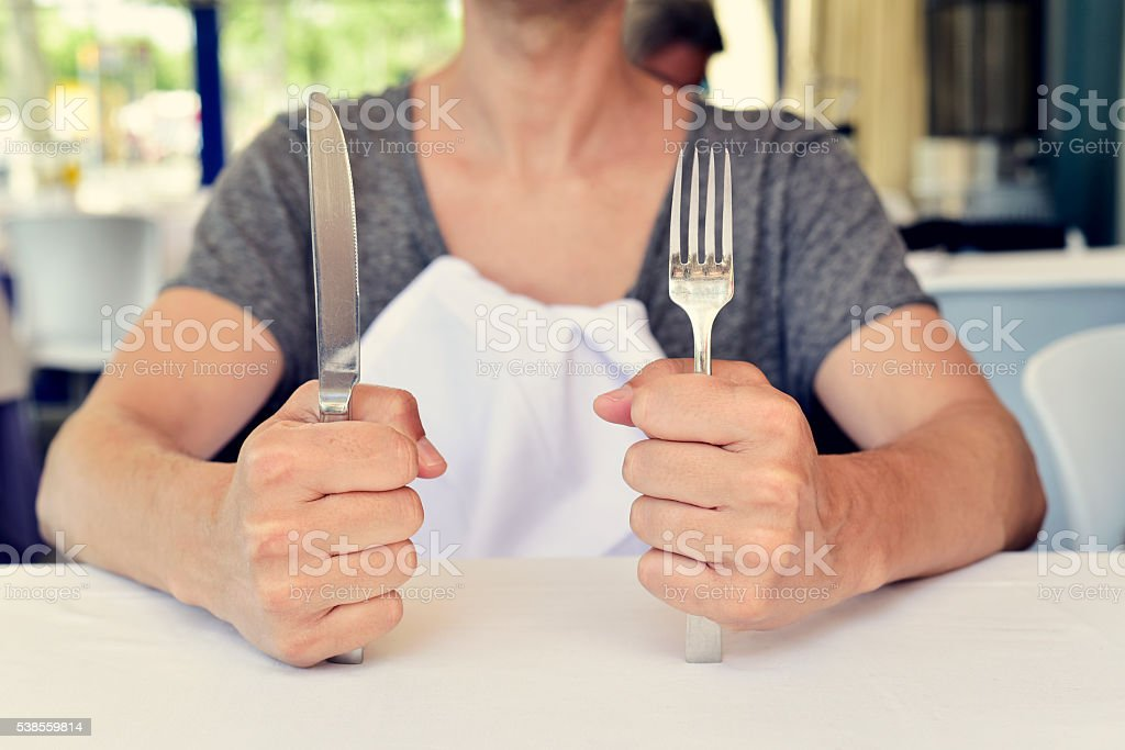 young man waiting for the food stock photo