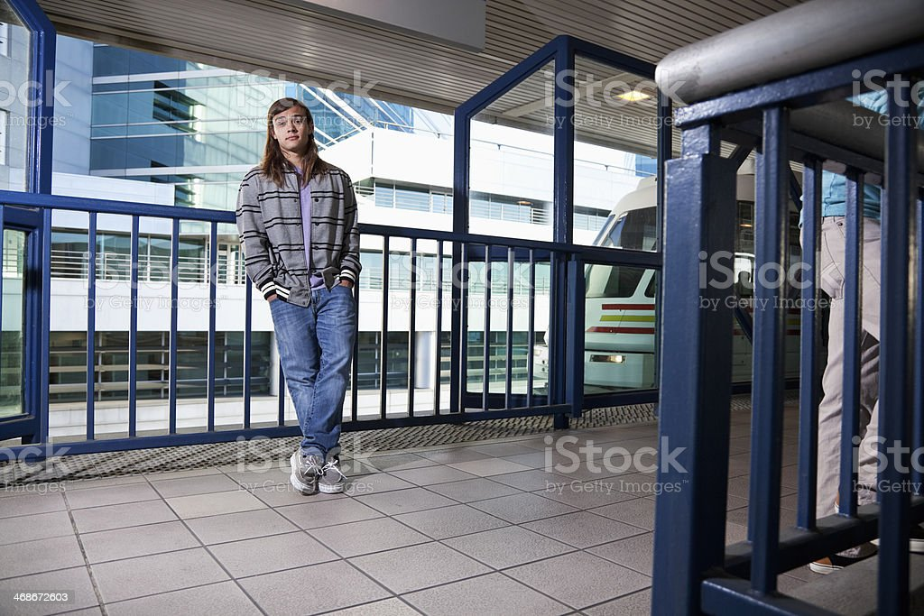 Young man waiting for tram stock photo