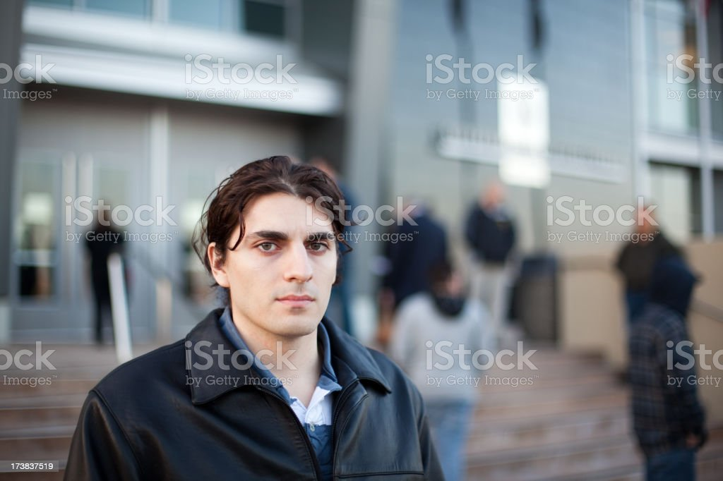 Young Man Waiting In Front Of a Building stock photo