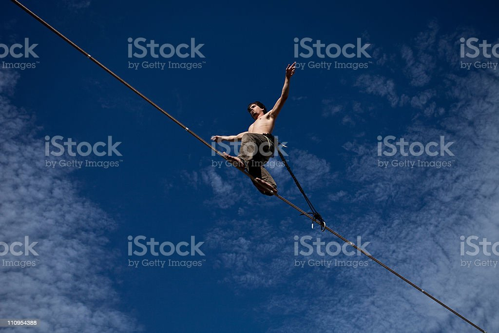 Young Man Walking a Highline stock photo