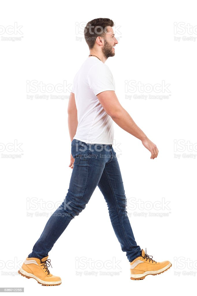 Young man walking in jeans and white t-shirt stock photo