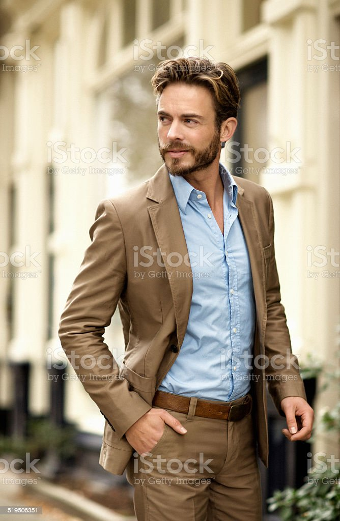 Young man walking on a european street stock photo
