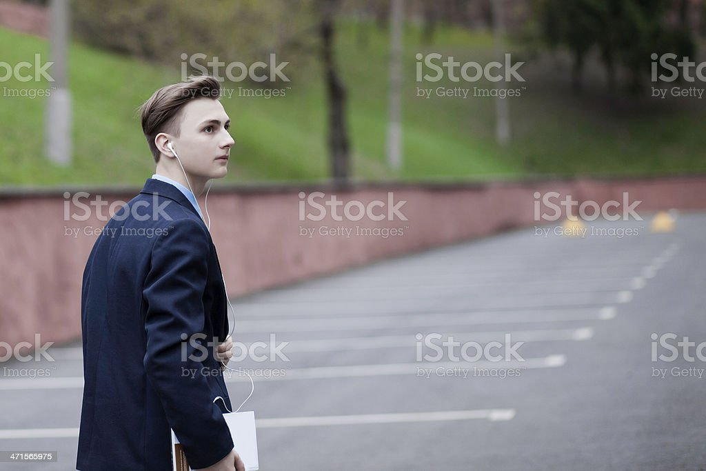 Young man walking the parking royalty-free stock photo