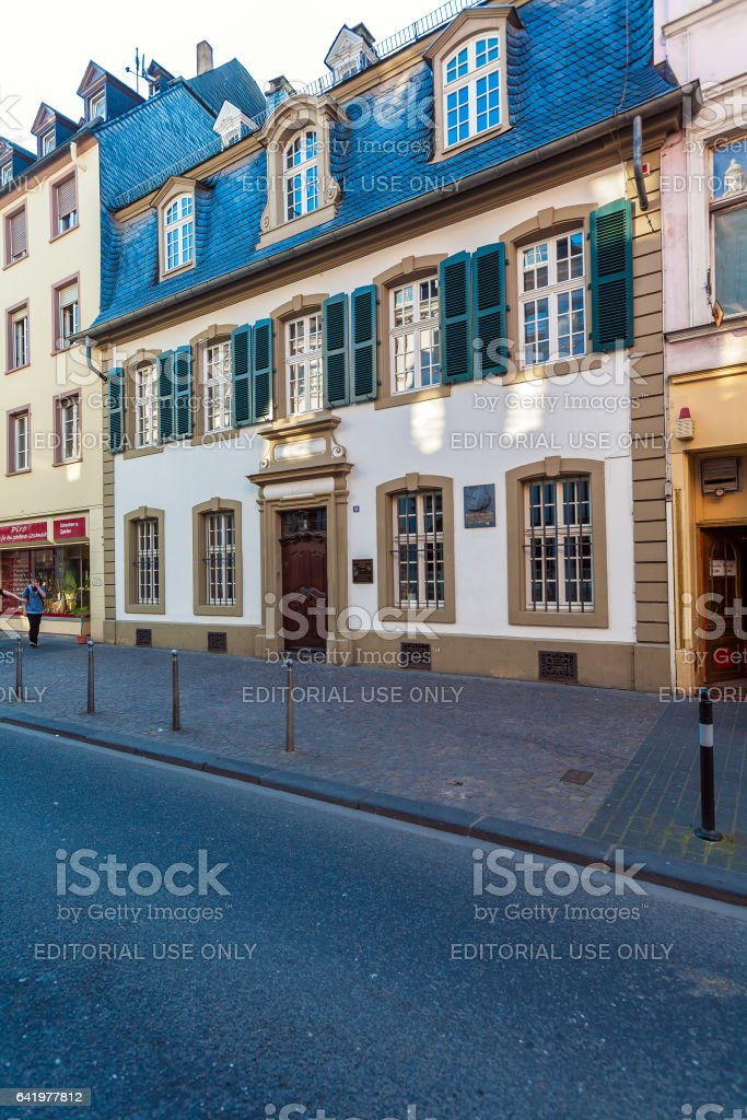 TRIER, GERMANY - APRIL 7, 2008: A young man walks  in front of the building, where was born Karl Marx stock photo