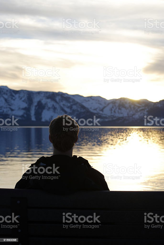 Young Man Watching Lake Tahoe, CA Sunset royalty-free stock photo