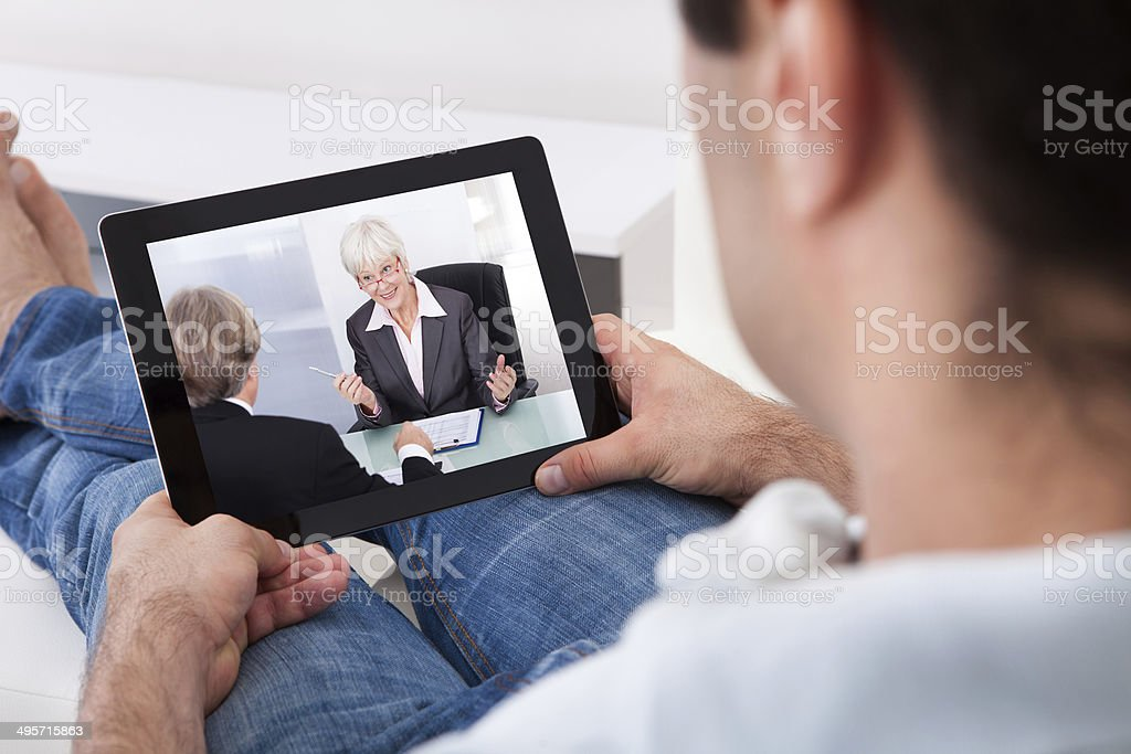 Young Man Watching Movie On Tablet Pc royalty-free stock photo