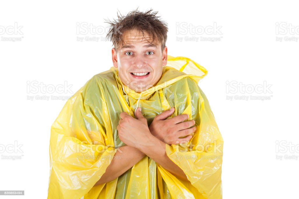 Young man wearing a yellow raincoat stock photo