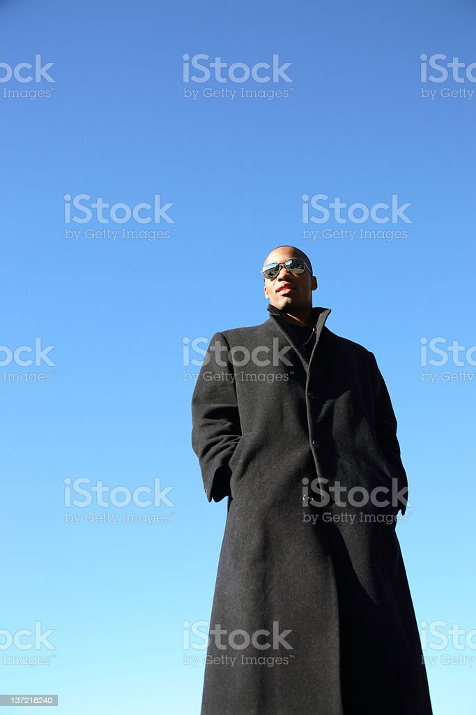 Young man wearing an overcoat stock photo