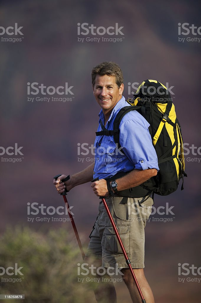 Young Man Wearing Backpack Standing In The Desert royalty-free stock photo