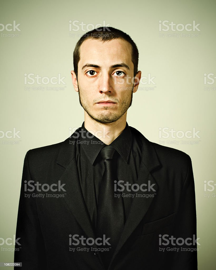 Young Man Wearing Black Suit and Tie stock photo