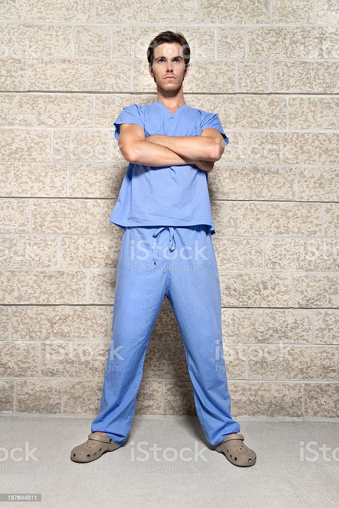 Young Man Wearing Blue Scrubs stock photo