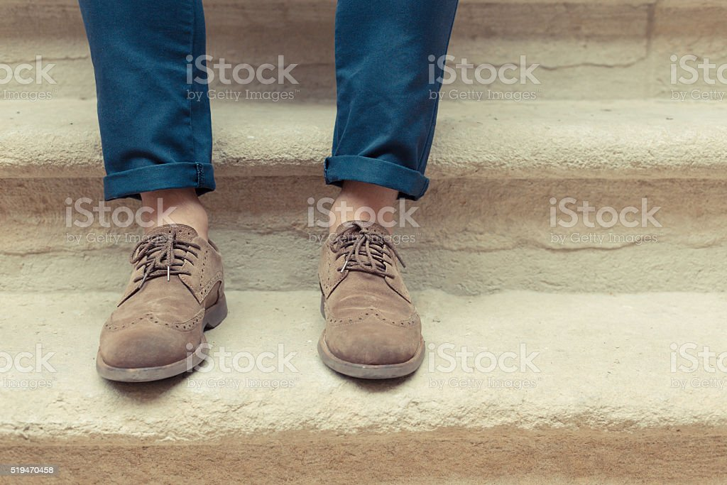 Young man wearing brown chamois shoes stock photo