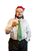 Young  man wearing Christmas hat with glass of champagne isolated